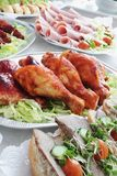 Cold meat buffet. Table featuring chicken drumsticks Stock Photo