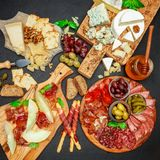 Cold meat cheese plate with salami chorizo sausage, prosciutto and cheese Royalty Free Stock Images
