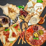 Cold meat cheese plate with salami chorizo sausage, prosciutto, cheese and wine. Cold meat cheese plate with salami chorizo sausage, prosciutto and various type royalty free stock photos