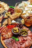Cold meat cheese plate with salami chorizo sausage, prosciutto, cheese and wine. Cold meat cheese plate with salami chorizo sausage, prosciutto and various type royalty free stock image