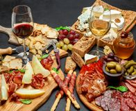 Cold meat cheese plate with salami chorizo sausage, prosciutto, cheese and wine. Cold meat cheese plate with salami chorizo sausage, prosciutto and various type royalty free stock images
