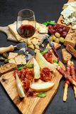 Cold meat cheese plate with salami chorizo sausage, prosciutto, cheese and wine. Cold meat cheese plate with salami chorizo sausage, prosciutto and various type stock photo