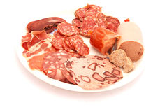 Cold meat cuts. Cuts of cold meat on a white breakfast plate royalty free stock photos