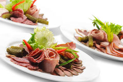 Cold Meat Dish. Sliced Meat Plate with Fresh Salad Leaf and Pickled Vegetables stock images
