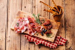 Cold meat plate and bread sticks Royalty Free Stock Image