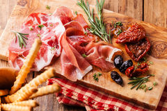 Cold meat plate and bread sticks Stock Image