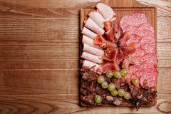 Cold meat plate, slices prosciutto, ham,beef jerky, sausage Stock Images