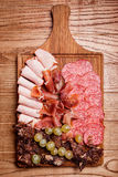 Cold meat plate, slices prosciutto, ham,beef jerky, sausage Stock Image