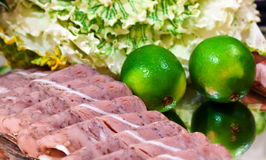 Cold meat platter. Cold meat with lime on a platter Royalty Free Stock Photos