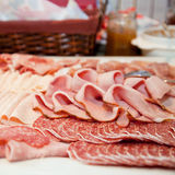 Cold meat platter on a buffet table. Cold meat platter with an assortment of different meats displayed on a buffet table at a catered event Stock Photos