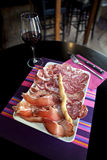 Cold meat and wine Stock Images