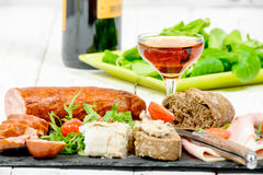Cold meats plate with glass of wine Stock Image