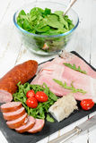 Cold meats plate with tomatoes. Cold meats plate with salad and tomatoes royalty free stock images