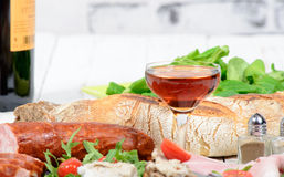 Cold meats plate with wine Royalty Free Stock Image