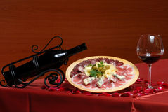 Cold meats with red wine Royalty Free Stock Photos