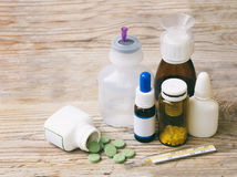 Cold medicines - pill, syrup, drop, ampoule, syringe Royalty Free Stock Images