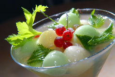 Cold melon soup with red currant Royalty Free Stock Images