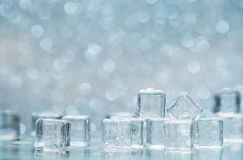 Cold melting ice cubes with water drops on blured background Royalty Free Stock Photo