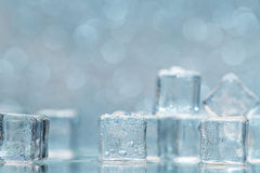 Cold melting ice cubes with water drops on blured background Royalty Free Stock Photos