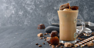 Cold milk with coffee ice. On a gray background Stock Photo
