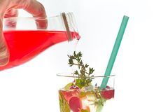 Cold mint berry cocktail in a sling isolated on white. copy space. summer refreshing drink with a straw.free space for text. Cold mint berry cocktail in a sling stock images