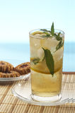 Cold mint tea. Cool green tea with mint and ice royalty free stock photos