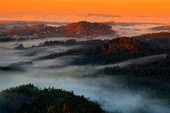 Cold misty foggy morning in a fall valley of Bohemian Switzerland park. Hills with fog, landscape of Czech Republic, National Park Royalty Free Stock Photos