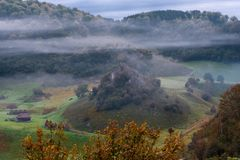 Cold misty morning in stunning remote location, Fundatura Ponorului village, Romania royalty free stock images