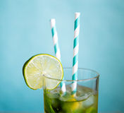 Cold mojito cocktail with ice and straw Stock Photos