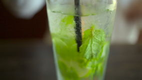 Cold Mojito cocktail with ice stock video footage