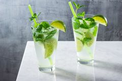Cold Mojito Cocktails with Mint and Lime on Bar Royalty Free Stock Photo