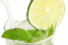 Cold Mojito drink. Mojito drink with ice, lime and mint Royalty Free Stock Image