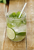 Cold mojito with a straw Royalty Free Stock Photos