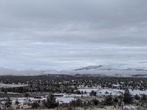 Cold morning. Over looking the valley, east Oregon, juniper trees, little snow, horse shed, cloudy snowy weather stock photos