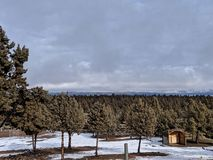 Cold morning. Over looking the valley, east Oregon, juniper trees, little snow, horse shed, cloudy snowy weather stock images