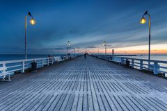 Cold morning at Pier in Sopot. Sunrise with amazing colorful sky. Winter in Poland. Cold morning at Pier in Sopot Royalty Free Stock Photography