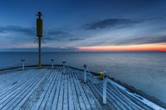 Cold morning at Pier in Sopot. Sunrise with amazing colorful sky. Winter in Poland. Cold morning at Pier in Sopot Royalty Free Stock Image