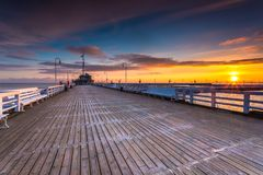 Cold morning at Pier in Sopot. Sunrise with amazing colorful sky. Winter in Poland. Cold morning at Pier in Sopot Royalty Free Stock Photos