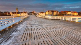Cold morning at Pier in Sopot. Sunrise with amazing colorful sky. Winter in Poland. Cold morning at Pier in Sopot Stock Photos