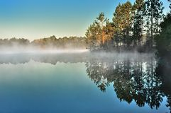 Cold Morning Rising. Of the sun the water is warmer than the air making perfect conditions of the fog Stock Photos