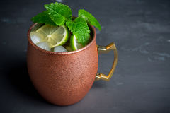 Cold Moscow Mule cocktail in copper mug on the rustic background. Shallow depth of field royalty free stock photos