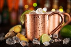 Cold Moscow Mules - Ginger Beer, lime and Vodka Stock Image