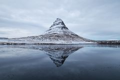 Cold Mountain. Kirkjufell reflected in a lake on a cold day Stock Image