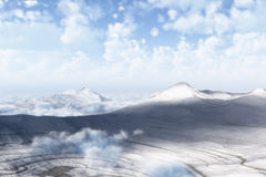 Cold Mountains. Snow covered mountains with mist and clouds and moon in the cold blue sky Royalty Free Stock Photo