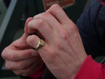 Gold signet ring. On left hand Royalty Free Stock Photography