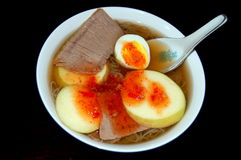 Cold noodle soup. A bowl of korean cold noodle with sliced egg, beef and apple Stock Photography