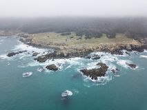 Aerial View of Scenic Northern California Coastline. The cold, nutrient-rich waters of the Pacific Ocean wash against the rocky northern California coastline in royalty free stock images