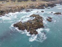 Aerial of Rocky Northern California Coastline. The cold, nutrient-rich waters of the Pacific Ocean wash against the rocky northern California coastline in Sonoma royalty free stock photo