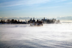 Cold ocean. Ship along the side of a cold ocean steaming at sunrise Royalty Free Stock Photography