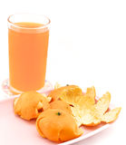 Cold orange juice with peel. Cold orange juice in glass placed on coasters and orange peel with white background Royalty Free Stock Images